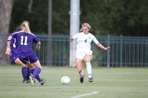 Alumna Emory Cason takes the ball downfield against Kansas State where she scored her first collegiate goal. (Photo courtesy of Baylor University Athletic Department)