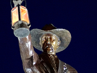 Grapevine city hall is decorated with a statue of the night watchman who guarded Main Street in the pioneer days.