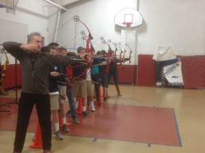 Coach Tommy Sugg leads the junior high archery program in Faith's Outdoor Education class. The students shoot three days a week in the Worth Street gym.