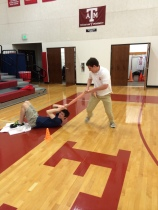 Senior William Deal pulls classmate Chase Tehan in bobsled. (Photo Courtesy of Brandon Whiteley)