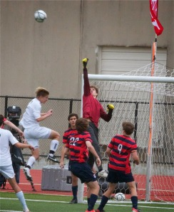 Senior goalkeeper Chapman Odom punches away the ball on an Awty International corner kick. (Photo courtesy of Aimee Reeves)