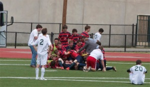 The soccer team celebrates its fourth straight State Championship after defeating Houston Awty International 2-1. (Photo courtesy of Aimee Reeves)