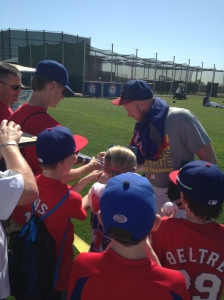 Rangers' pitcher Robbie Ross signs autographs for fans after a Spring Training workout at the Rangers' practice facility in Surprise, Arizona. (Photo courtesy of Sandra Ogden)