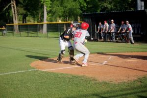 Senior Brady Stallings scores a run after colliding with All-Saints' catcher. (Photo courtesy of Grapevine Faith Athletic Department)