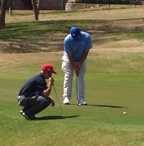 Sophomore Dawson Parmely lines up his putt while his opponent takes a shot of his own. (Photo courtesy of Grapevine Faith Athletic Department)