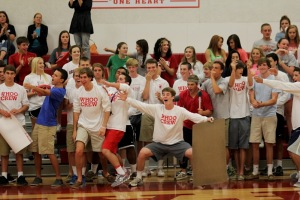 Senior Bryce Wasserman and his famous white board helped lead the Whoo Crew and rally the volleyball team. Photo from RAWR Archives)
